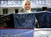 50 Bosnian women, relatives of victims of the Srebrenica massacre gather seen here holding a banner with the 8106 names of the victims in front of the International Court of Justice in The Hague, in February 2006. The United States deported to Bosnia two Bosnian Serbs wanted by a local court on charges of genocide committed in the 1995 Srebrenica massacre, an official said.(AFP/ANP/File/Ilvy Njiokiktjien)