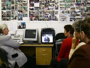 Bosnian Muslim women survivors of the Srebrenica massacre gesture as they watch on TV the verdict on Momcilo Krajisnik, a former high-ranking Bosnian Serb politician accused of genocide over the brutal campaign of ethnic cleansing during the 1992-95 war in Bosnia, at the Union of Srebrenica women in Sarajevo on Wednesday, Sept. 27, 2006. The U.N. tribunal sentenced Bosnian Serb politician Momcilo Krajisnik on Wednesday to 27 years in prison for crimes against humanity committed during the 1992-95 Bosnian war.