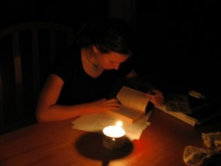 Grace studies by candlelight