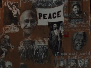 busboys and poets wall painting of Ghandi and King and other heroic peaceful leaders