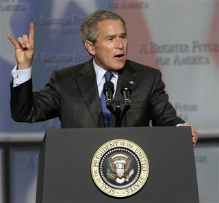 Bush Flashes Devil Sign (Again)
