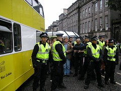 A police van stops the bus from leaving