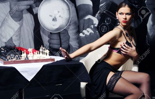 8673997-Young-and-sexy-vintage-woman-posing-beside-chess-table-Stock-Photo