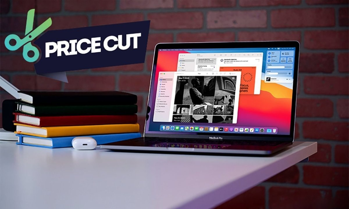 Apple MacBook Pro 13 inch on desk with price cut icon