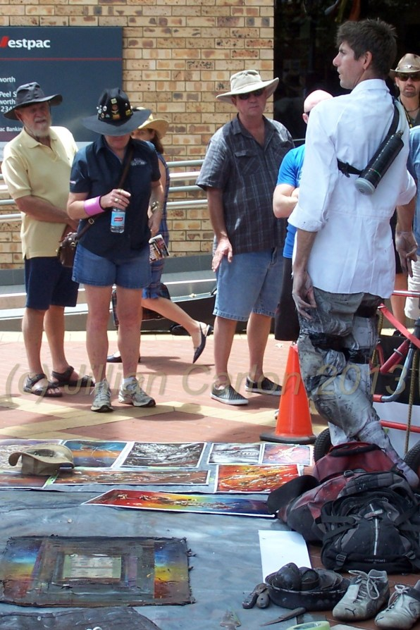 This young artist (man with white shirt on) sat on the footpath in the main street for the whole 10 days of the festival and just painted different works from scratch. He even sold a few.