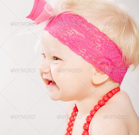 cute baby smiling wearing a red chain