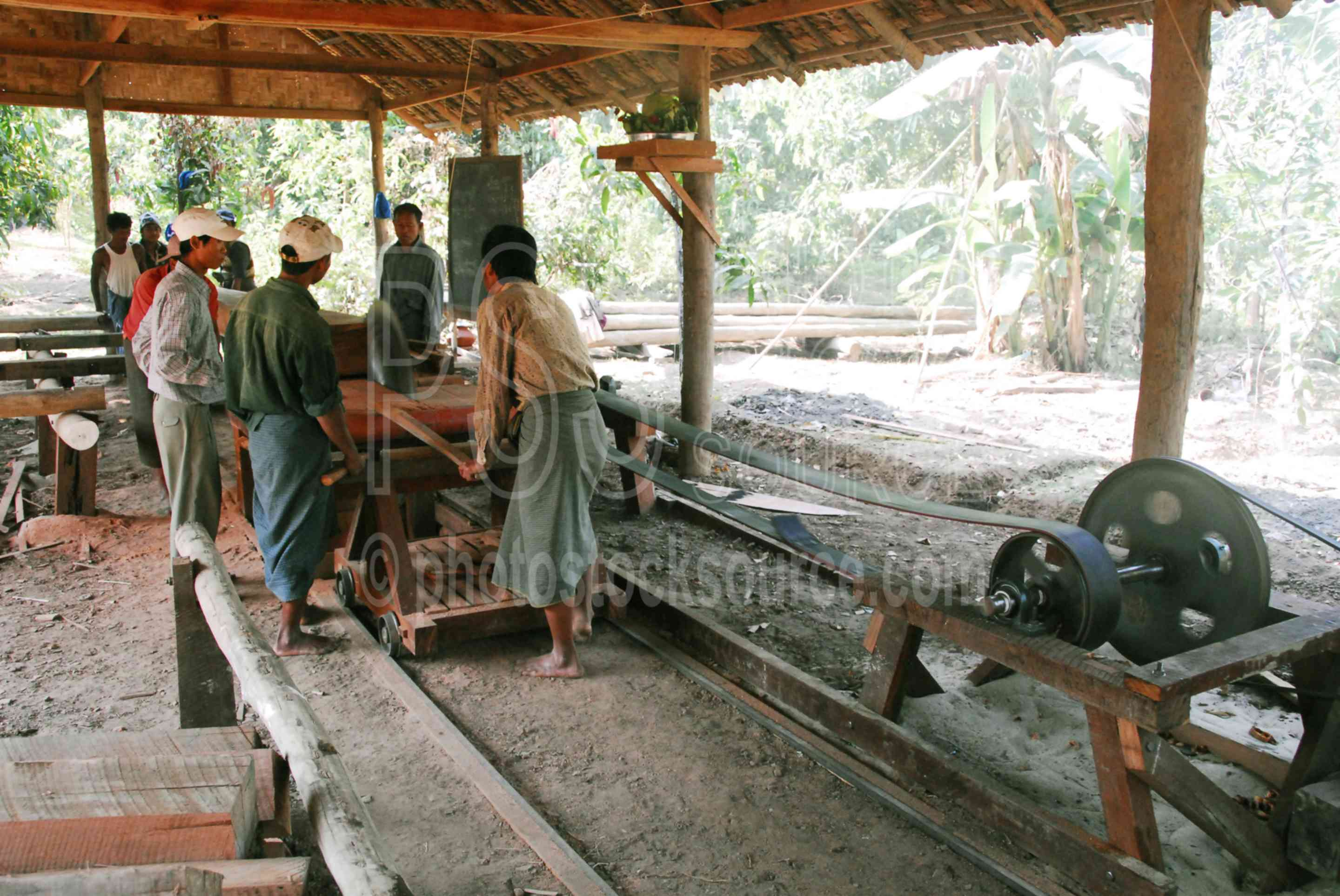 Photo Of Men Cutting Wooden Beam By Photo Stock Source