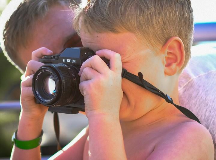 Young boy with Fuji mirrorless camera