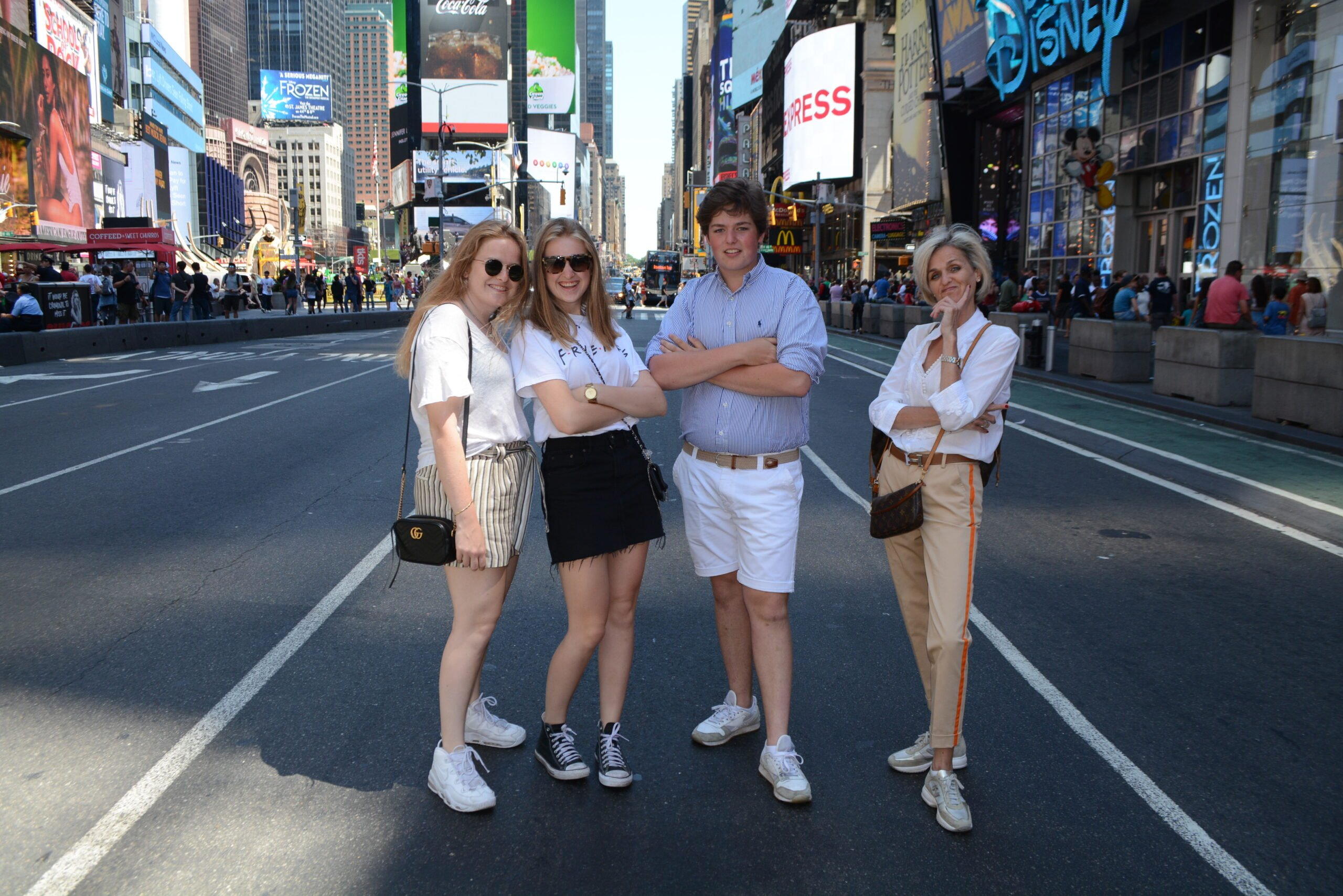 NYC Times Square with family on streets of Broadway with NYC photographer