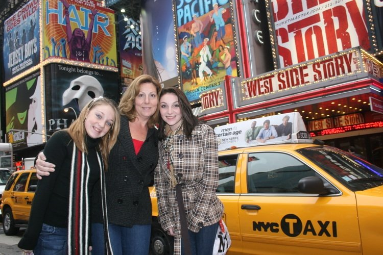 NYC taxis and cabs on Broadway with family on photoshoot with photographer