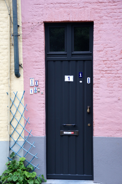 DOOR WITH MULTIPLE HOUSE NUMBERS, BRUGES, 2011