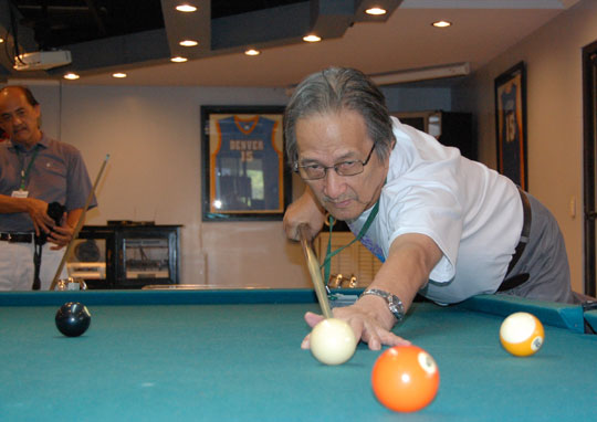 FPPF Director Lito Beltran enjoys a game of pool with Prof. Joey Tañedo after a day's work at the Quezon Power Plant. Ka Lito won, 5-3, over Joey.