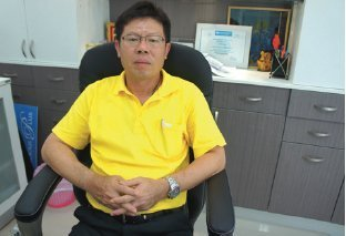 Khun Chumpol Dulyamahakamthorn Manager of Krungthai Bank (KTB) - Rassada Road Phuket Branch