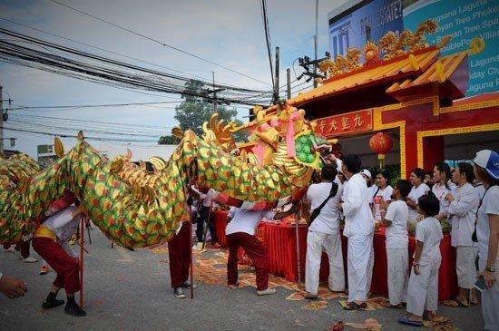 The procession includes  traditional Chinese dragon and lion parades.