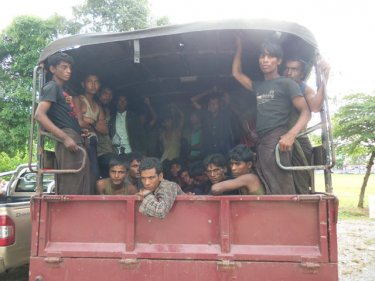 After a long voyage, Rohingya boatpeople are trucked  to the Thai Army