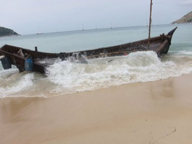 A Rohingya boat is battered by waves on Phuket earlier this year