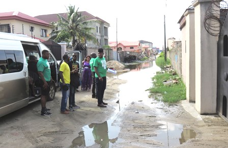 Disciples getting out of the van to cross the road to go into the orphanage!