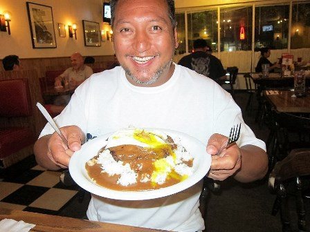 """Mark Garrido is """"at home"""" in the Islands as he enjoys the Loco Moco! His """"down home"""" preaching has literally radicalized the Big Island in just one month!"""