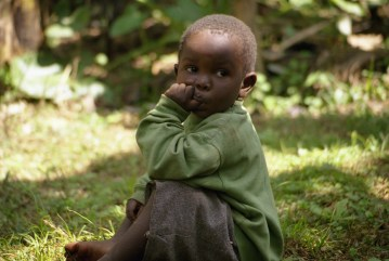 A Chagga child of age 5, grandson of the Chagga chief, stared at the foreigners.