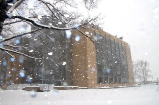 With the Science Facility in the background, the snow droplets turns into little blue lights.