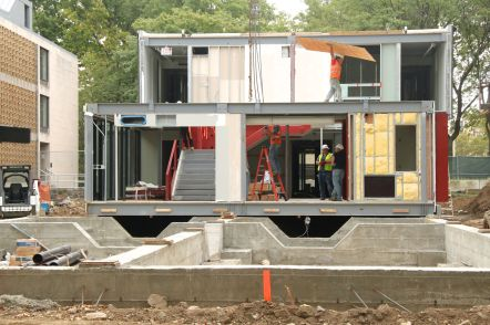 The modules that were built off site not only include structural frames and windows, but also a staircase and exit signs.