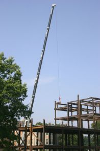 Compared to the steel structure, the crane is estimated six stories high.
