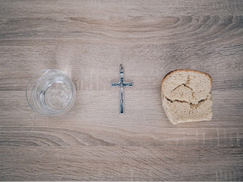 short-history-fasting-bread-cross-on-table