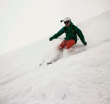 Image of Snowboarder Going Down Slope