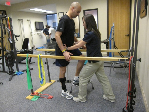 Full gait retraining in bars with physical therapist