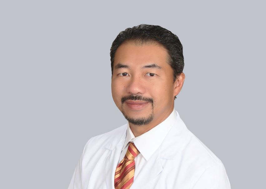 Man Q. Le, MD, laser spine in South Florida