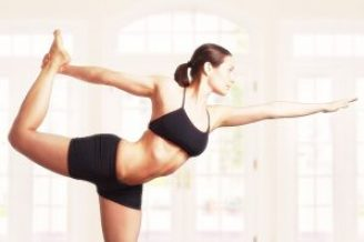 Young woman is doing an expert yoga exercise.