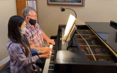 Kylie and John Douglas Playing Sonatina in C major opus 3 #1 by Carl Maria von Weber.
