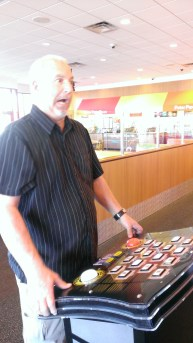 Papa in an intense game of Deal or No Deal for tickets.