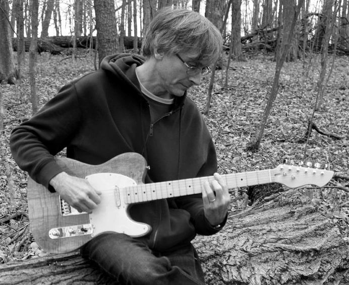 Sylvain playing guitar