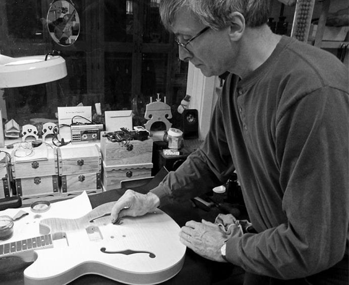Sylvain staining guitar