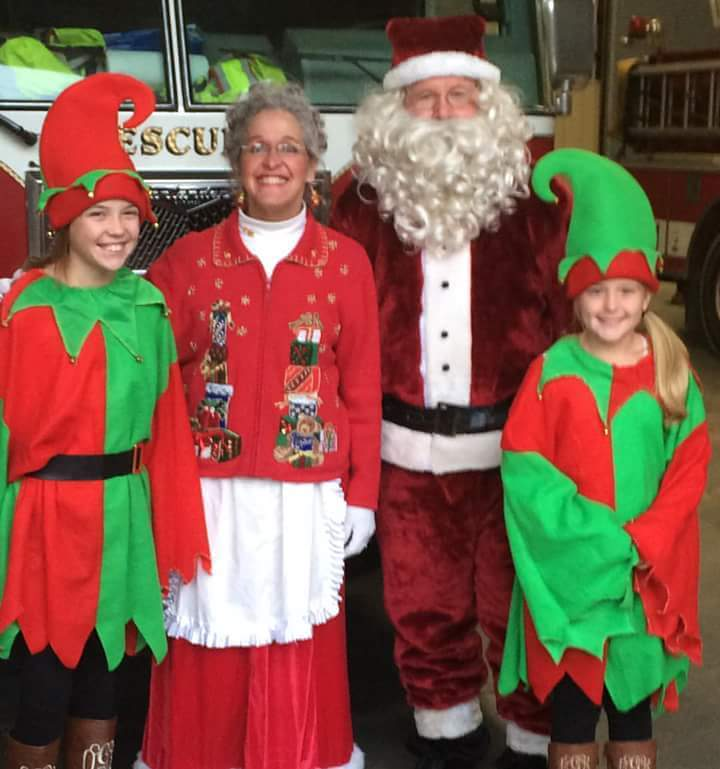 Santa, Mrs. Clause, and their elves