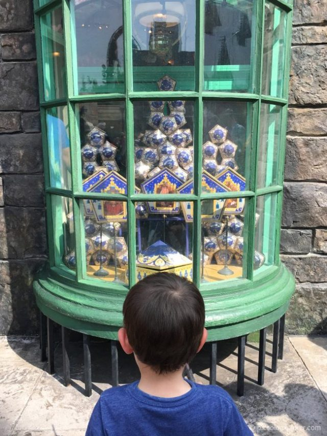 Using an interactive wand at The Wizarding World of Harry Potter, Orlando, Florida