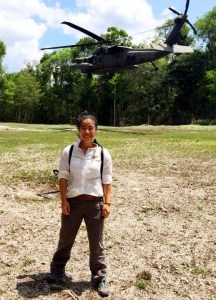 Emily Yu in Guatemala in Front of Helicopter