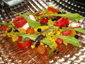 Heirloom tomato salad with Burratta cheese and all kind of fresh vegetables and fruits