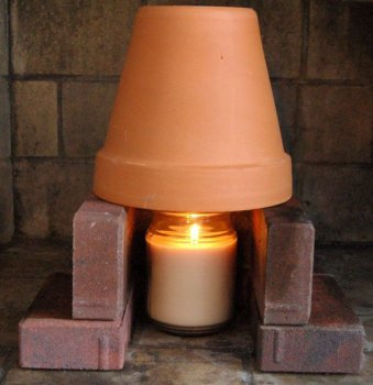 36-cold-weather-hacks-to-keep-you-cozy-this-winter-terra-cotta-pot-heater
