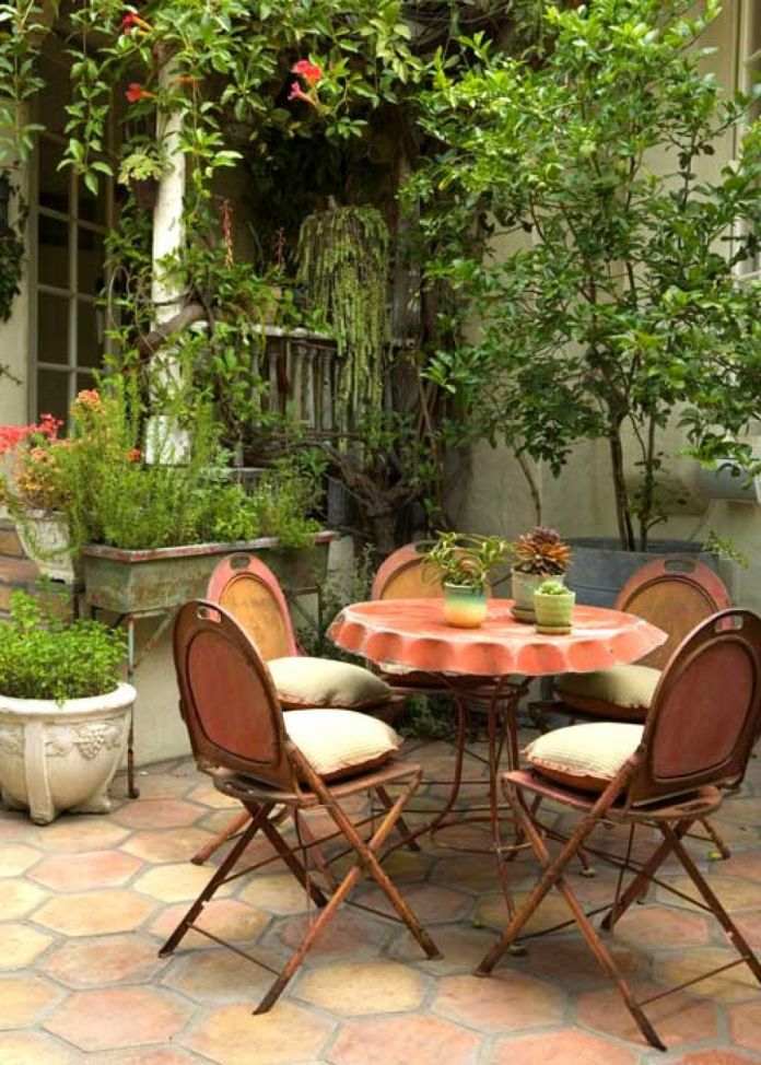 Beautiful-patio-dining-area-with-rustic-metal-chairs-and-small-round-table-best-for-small-spaces.