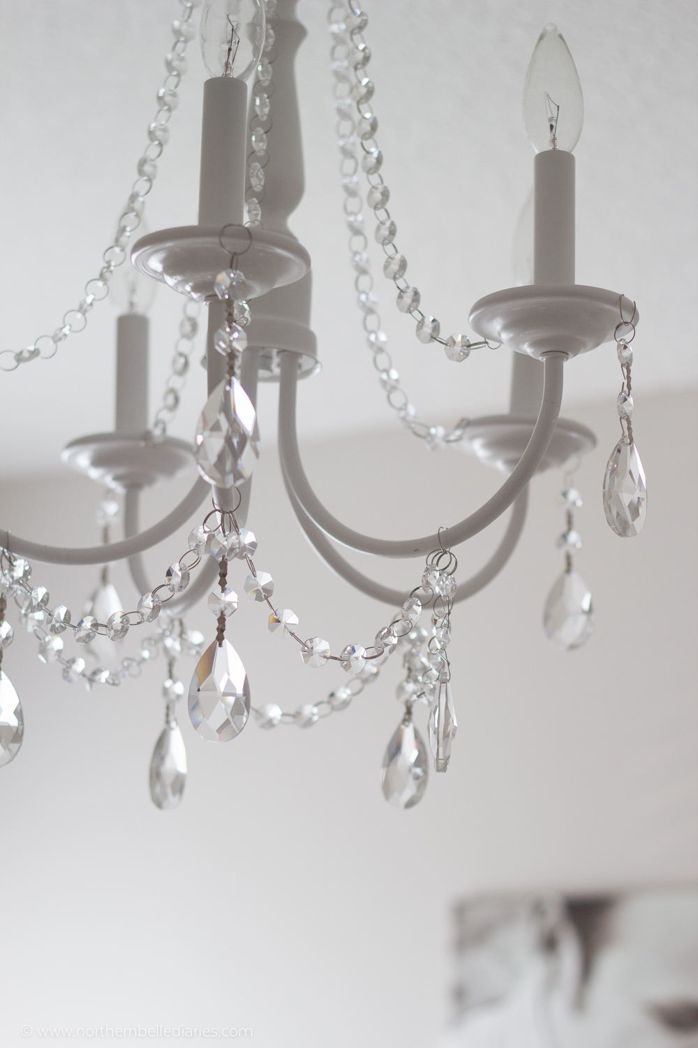 How to make your own diy crystal chandelier picky stitch you should just be working with the frame of the chandelier cover your chandelier with a coat of spray paint in the desired color arubaitofo Images