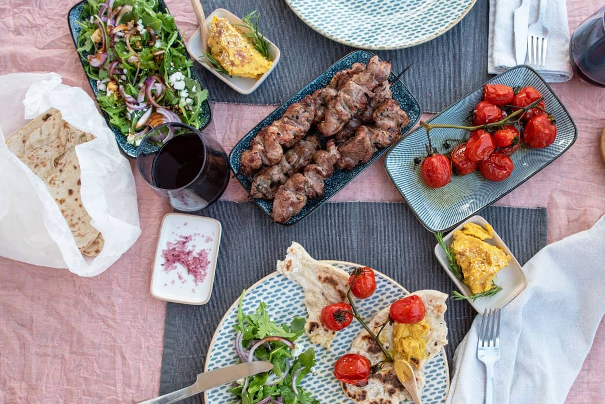 BBQ lamb kebabs with roasted vine tomatoes and smoked pumpkin hummus.