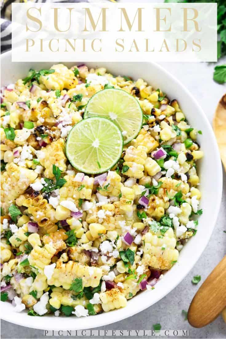 """Bowl of corn salad with lime garnish with text overlay - """"Summer picnic salads"""""""