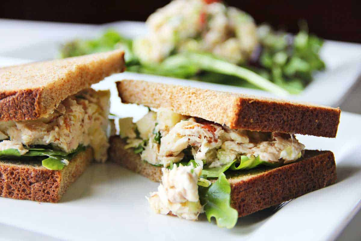 Tuna salad sandwich on a plate.