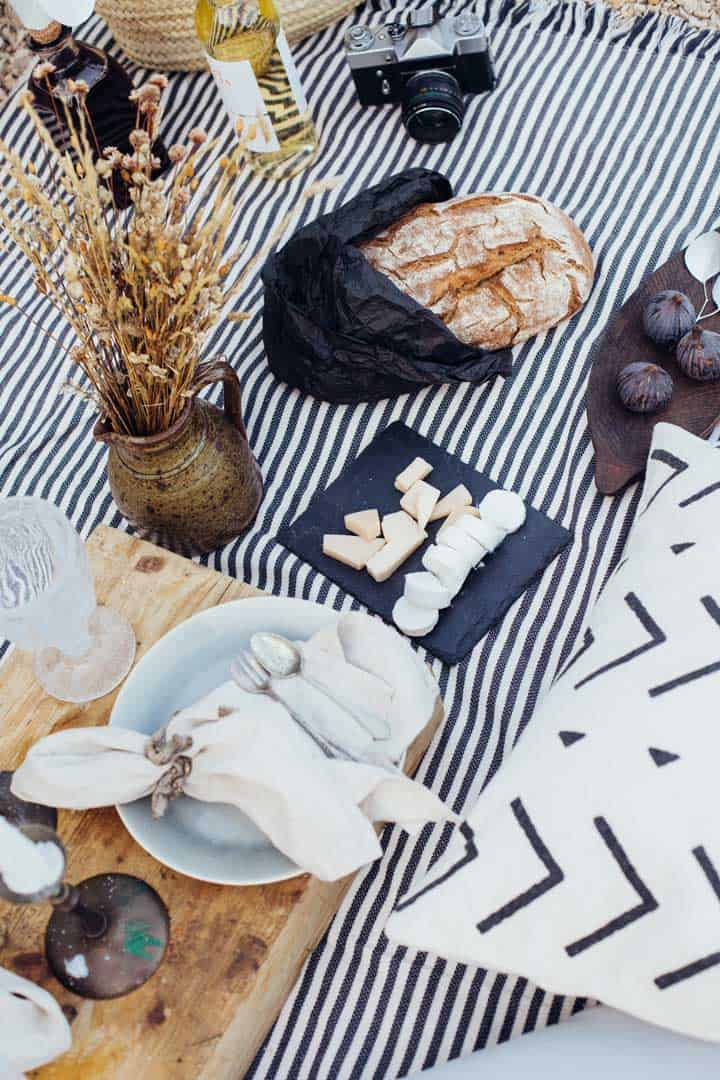Picnic layout with cheese and rustic bread.