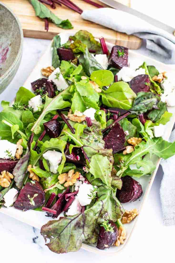 Colourful roasted beet salad with fresh greens, feta and walnuts.