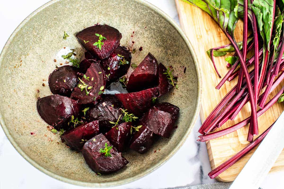 Bowl of roasted beets in balsamic dressing.