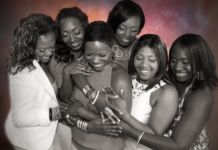 black women hugging