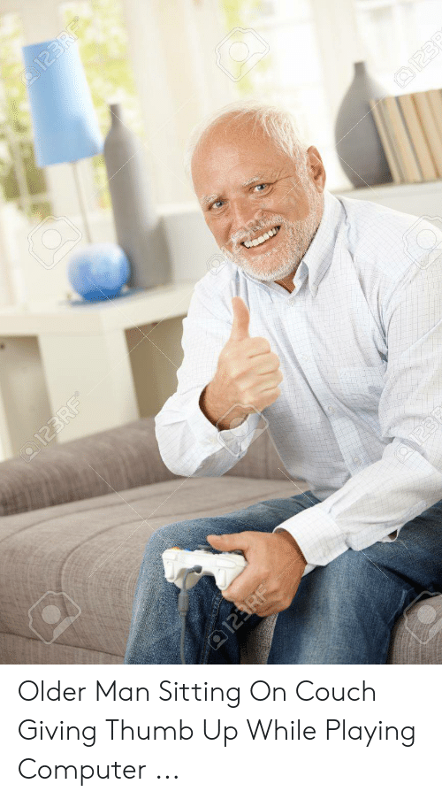 Older Man Sitting On Couch Giving Thumb Up While Playing Computer